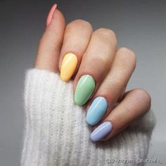 "If you're unfamiliar with nail trends and you hear the words ""coffin nails,"" what comes to mind? It's not nails with coffins drawn on them. It's long nails with a square tip, and the look has. Pastel Color Nails, Nail Polish Colors, Pastel Colors, Colorful Nails, Yellow Nails, Pastel Purple, Purple Nails, Bright Colors, Cute Nails"