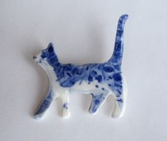 delft porcelain pin.