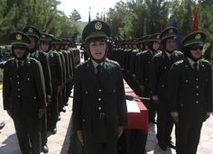 Female Afghan National Army (ANA) officers attend their graduation ceremony at the Kabul Military Training Centre August 24, 2014. (REUTERS/Omar Sobhani)