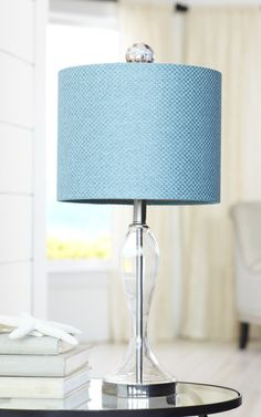 The vibrant color, punch of texture and simple silhouette of our Marine Glass Lamp can complement a nautical-theme