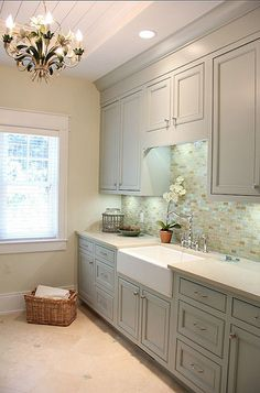 a gorgeous neutral (not white) laundry room in taupes and grays, by Sears Architects.