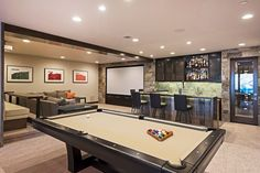 The ultimate entertainment room comes complete with a home theater, pool table, and wet bar.