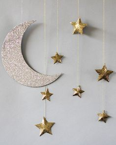 Bring the night sky wherever you go, with these hanging moon and stars baby shower decorations.