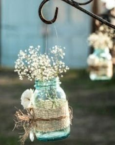 Blue mason jar covered in burlap, twine and topped with some baby's breath.  Could also be used as a centerpiece.