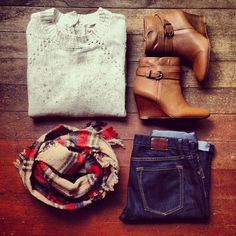 Booties and a plaid scarf paired with skinny jeans and an oversize neutral sweater