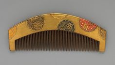 Lacquer Comb with Flower-Shaped Roundels, Edo (1615–1868) or Meiji period (1868–1912), mid-19th century, Japan, Lacquered wood with gold, silver, red hiramaki-e on gold ground, W. 4 1/2 in. (11.4 cm)