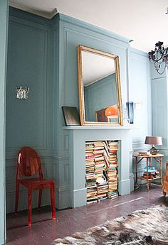 Fireplace inspiration: fireplace as a storage for books