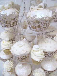 Ivory wedding cupcake tower. I love that mini cupcakes are incorporated.