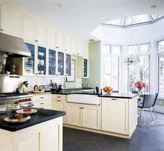 A gorgeous cream and white farmhouse kitchen in the city. White Farmhouse Kitchens, Farmhouse Style Kitchen, Black Kitchens, Home Kitchens, Dream Kitchens, Dining Area, Kitchen Dining, Kitchen Cabinets, Cream Cabinets