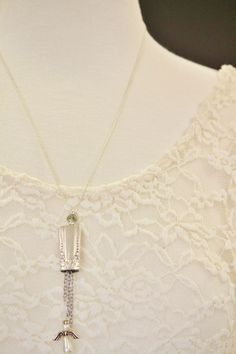These bell charm necklaces are so sweet! Each bell is made from the tip of a butter knife's handle.