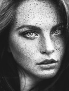 Lovely portrait of a women with amazing freckles.