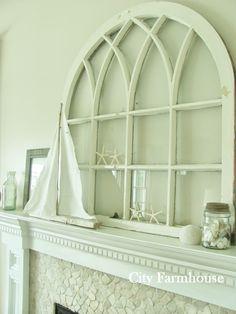 Love that old window.  City Farmhouse Blog