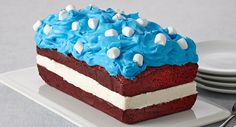 Ice cream is sandwiched between fudgy brownie layers for a cool summertime treat. Decorate it for the 4th of July with blue-tinted whipped topping and mini marshmallows.
