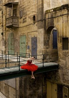 Maltese model Chanelle on the bridge spanning East Street in Valletta during a fashion shoot by London-based photographer Rebecca Miller