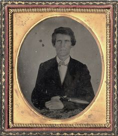 "'Ambrotype of Tailor, Man with Paisley Cloth and Large Scissors by Photo_History, via Flickr' Owner's info: 'The man in this quarter plate ambrotype poses with a length of paisley cloth across his lap and a large pair of scissors in his left hand. (Amborytpes are mirror images.) We call him ""The Tailor."" Cased images that include occupational tools are especially prized.'  #photography #ambrotype #nineteenthcentury #scissors #CUTlery"