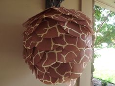"Giraffe print paper lantern 12""  Decorate for your wedding shower or wedding reception with these paper lanterns! They are perfect for hanging as ceiling decorations, porch decorations and more.  The tissue paper lanterns are a fun twist on the regular tissue paper pom poms."