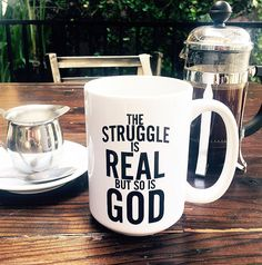 """The Struggle Is Real But So Is God Coffee Mug was designed to uplift you. Inspired by Isaiah 41:13, """"For I am the LORD your God who takes hold of your right han"""