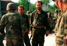 Kosovo Liberation Army members surrender their weapons and ammunition to US Marines, 1999.
