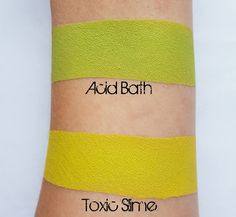 Swatches of loose eyeshadow pigments Acid Bath and Toxic Slime.  Both colors are vegan and cruelty free, Mazzie Cosmetics.
