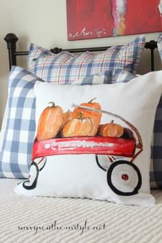 fall decor in a guest room, farmhouse style, fall painted pillow, pumpkins, plaid shams, buffalo checked pillows, little red wagon pillow