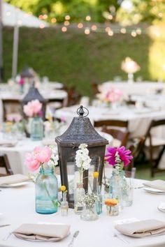Lantern centerpiece | A Pink Vintage Chic North Carolina Wedding via TheELD.com