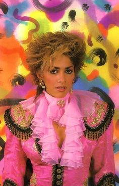 Sheila E .I aspired to have my hair like this-there is a LOT of empty cans of Aqua Net in my past, I fear...