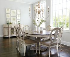 """Our best-selling """"Salento"""" chandelier is as light and graceful as a ballerina, with swooping steel arms and an antiqued finish. The set of five white ceramic pitchers is both decorative and useful for serving or foliage, and framed intaglios make an artful wall arrangement. #dining #chandelier #horchow"""