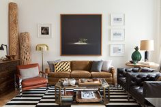love everything about this room- the logs in the corner- the green vase? the brown and gold accents.
