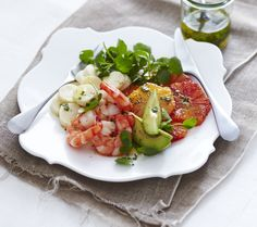 Shrimp, hearts of palm, avocado and blood orange salad with honey, lime & vinegar dressing.