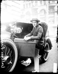 Wallace Reid and one of his many cars (this one is a McFarlane)