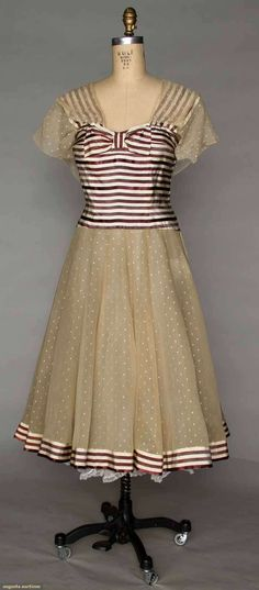 Chanel Summer Dress, 1956 {Augusta Auction}   It's actually a stole, but like the idea of lace overlay, strapped bodice, hem treatment