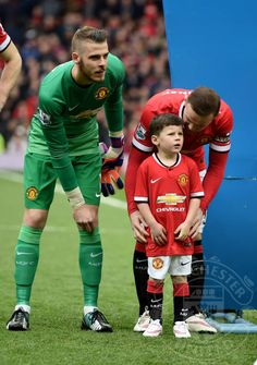 Wayne Rooney of Manchester United walks out onto the pitch with his son Kai, who is a mascot for the day during the Barclays Premier League match between Manchester United and Tottenham Hotspur at Old Trafford on March 15, 2015 in Manchester, England.