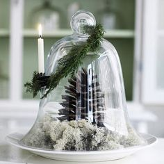 This would be cute using a wine glass inverted over the pine cone and greenery with a candle on the top