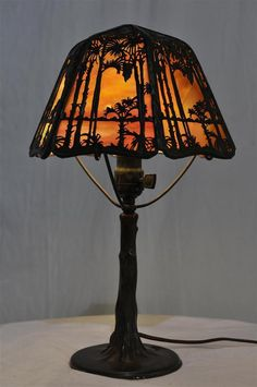 Six sided shade with palm tree overlay. Shade is tight, marked Handel and in wonderful condition. Vintage Lamps, Overlay, Boudoir, Mirrors, Palm, Table Lamp, Shades, Lights, Sunset