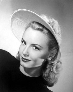 """1944; Janet Blair chose a versatile hat for her summer wardrobe, for it may be worn as a complete hat, or the brim or crown may be worn separately. Here Miss Blair wears only the pink straw braid brim."""""""