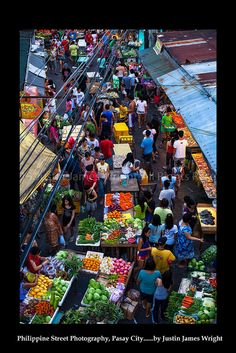 A busy street scene of a fruit and vegtable market in Malibay, Pasay City, Manila, Philippines. Philippine Street Photography by Justin Wright.