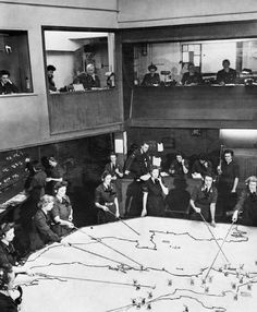 The Operations Room at RAF Fighter Command's No. 10 Group Headquarters, Rudloe Manor (RAF Box), Wiltshire, showing WAAF plotters and duty officers at work, 1943.