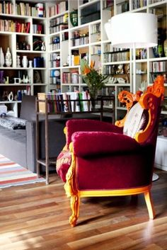Love the crazy rococo chair in this modern room. Reading in that chair must make one feel like a queen.