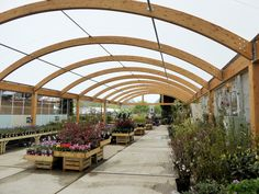 Situated adjacent to the beautiful Sir Harold Hillier Gardens, Hillier's site at Braishfield has a reputable plant area that is now accompanied by a large double span timber canopy, designed and built by Fordingbridge. Walkway, Canopy, Outdoor Gardens, Pergola, England, Garden Centre, Backyard, Outdoor Structures, Building