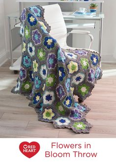 Flowers in Bloom Throw Free Crochet Pattern in Red Heart Yarns -- Bring a bit of spring into your studio or office with this flower-inspired throw. The hexagons crochet up separately, making this a great travel project.