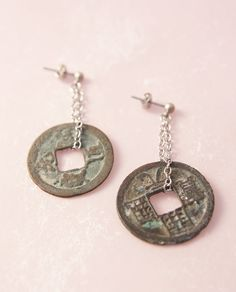These unique earrings are featuring two ancient Japanese coins. They are made of bronze which corroded into wonderful shades of powder blue,