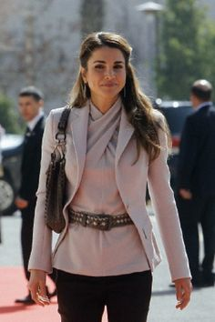 Jordan's Queen Rania arrives at the opening of the first session of the new parliament in Amman on 10 Feb 2013