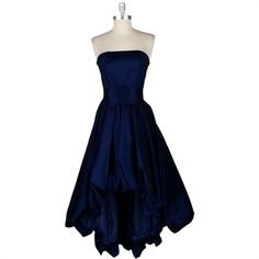 midnight blue color - bridesmaid dress. I would prefer a halter style. But I like the color and skirt part