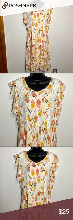 Lauren Conrad Large yellow peasant dress NWT Lauren Conrad Size Large, off-white, yellow, orange and green peasant dress with lace accents. Geometric floral type pattern. One button closure in the back behind neck. Elastic waist. NWT. Original price was $64. Excellent condition. Smoke free home.  Shell: 100% Rayon. Lining: 100% Polyester.  BUNDLE SPECIAL: 15% off 3 or more items from my closet! LC Lauren Conrad Dresses Midi