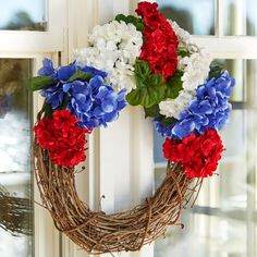 Show your American pride no matter the weather with this water resistant DIY Red White & Blue floral wreath.