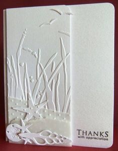 luv the two thirds fold over...use of embossing folder...die cut shells and layers of vellum on this delightful white on white card...
