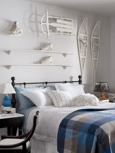 Modern Western Guest Room Fresh, white decors add new life to rustic, woodland interiors. A plaid blanket by L.L. Bean, laid across an iron bed from Bear Mountain Mercantile, lend additional color and pattern to a guest room. Read more: Bedroom Design Ideas - Guide to Bedroom Design - Country Living
