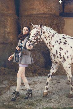 Fashion Editorial with horse and High Heels. fur neck BORSALINO, shoes GAETANO PERRONE
