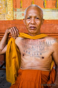 A Buddhist monk displays his tattoos at the Bakong Monastery in Cambodia.