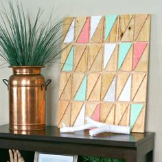 Learn how to take paint, plywood scraps, and a bit of gold leaf to make easy geometric wall art.